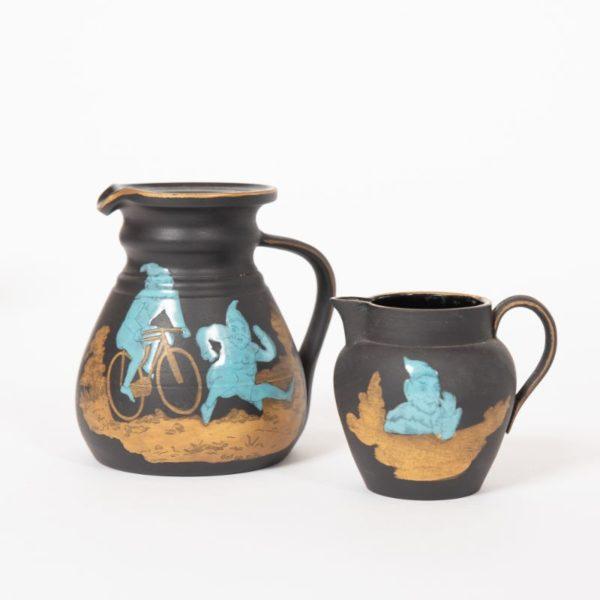 """Wedgwood black basalt enamelled """"Brownie"""" jugs c.1915"""
