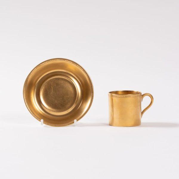 Rare Cauldon demi-tasse cup & saucer, rich all over gilt decoration