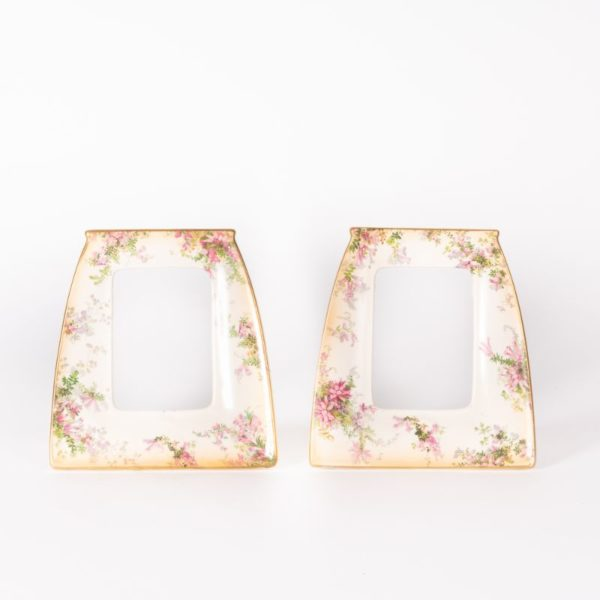 Pair Doulton porcelain photo frames