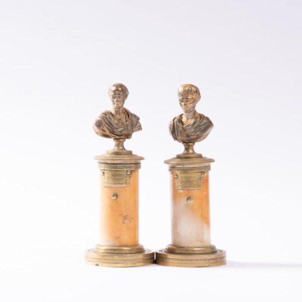 Pair gilt metal busts on pedestals