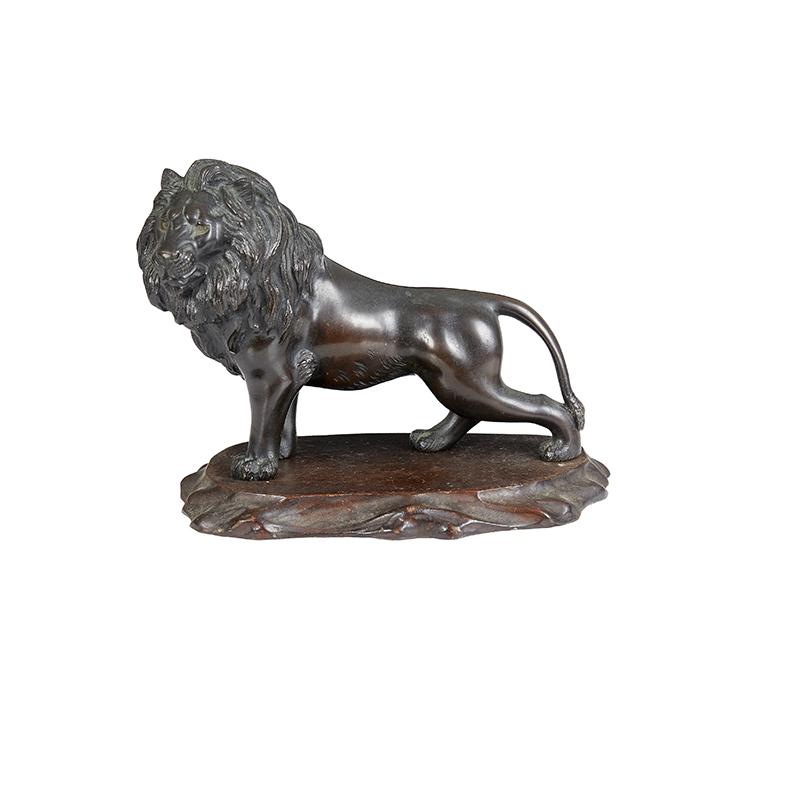 Japanese Bronze Lion on wood stand, Meiji period. Signed Nishimura. Meiji period c.1870.
